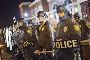Police stand guard during a demonstration outside the Ferguson Police Department, Sunday, Nov. 23, 2014. (AP Photo/David Goldman)