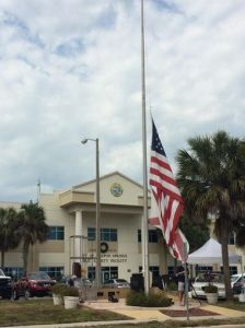 The American flag flies half staff at the Tarpon Springs Police Department  (Photo: WTSP)