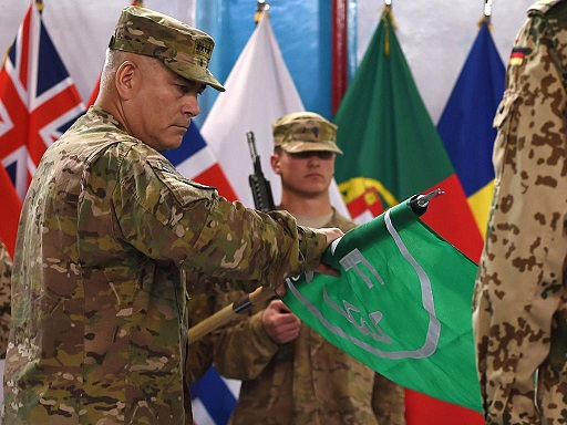 General John Campbell rolls up the International Security Assistance Force flag during the ceremony on Dec. 28, 2014 (photo: CBS)