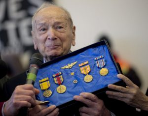 WWII Navy Veteran Dario Raschio with his medals and pins.