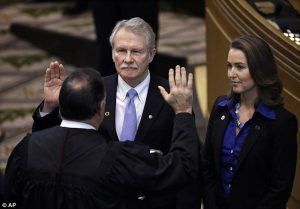 Former Oregon Governor John Kitzhaber and girlfriend Cylvia Hayes at his swearing in on January 12, 2015.  He resigned one month later.