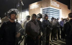 Police in riot gear outside of Ferguson Police Department