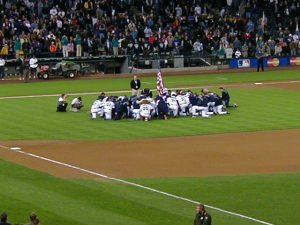 The team chaplain leads the Mariners in prayer