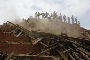 Volunteers help remove debris of a building that collapsed at Durbar Square, after an earthquake in Kathmandu, Nepal, Saturday, April 25, 2015. (AP Photo/ Niranjan Shrestha)