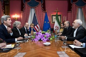 U.S. Secretary of State John Kerry (L), U.S. Secretary of Energy Ernest Moniz (2nd L), Head of the Iranian Atomic Energy Organisation Ali Akbar Salehi (2nd R) and Iranian Foreign Minister Javad Zarif (R) wait with others ahead of a meeting at the Beau Rivage Palace Hotel in Lausanne on March 26, 2015 during negotiations on the Iranian nuclear programme. REUTERS/Brendan Smialowski/Pool - RTR4UXKJ