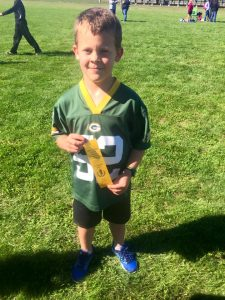 My athletic boy taking 4th place a few weeks ago in a Cross Country invitational.