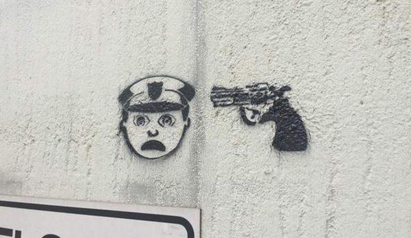 "Graffiti of ""Police Officer at Gunpoint"" Stenciled Around Houston (PHOTO)"