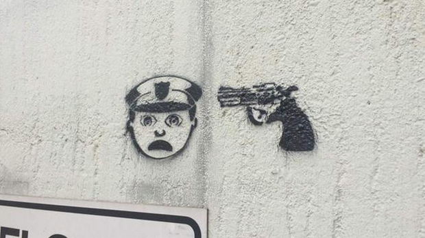 "Graffiti of ""Police Officer at Gunpoint"" Stenciled Around Houston (PHOTO)"
