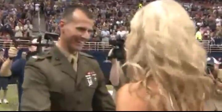 Marine cheerleader gets surprise from Marine husband