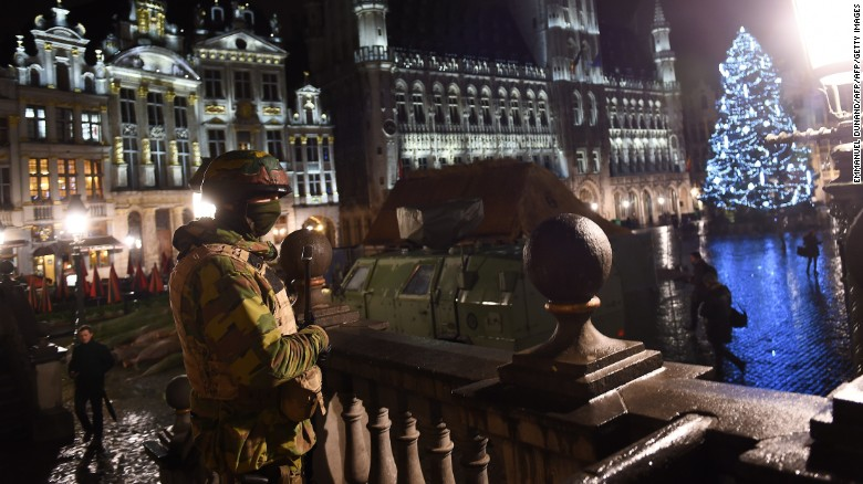 A Belgian soldier stands guard at Grand Place central square in Brussels on Sunday night (photo: AFP)