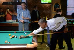 DENVER, CO - JULY 08: President Barack Obama plays pool with Colorado Governor John Hickenlooper at Wynkoop Brewery in downtown Denver after arriving in Colorado, July 08, 2014. President Obama is in Colorado to speak about the economy and raise money for Senator Mark Udall's re-election campaign. (Photo by RJ Sangosti/The Denver Post via Getty Images)
