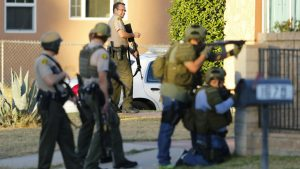 Police officers conduct a manhunt after a mass shooting in San Bernardino, California December 2, 2015. Gunmen opened fire on a holiday party on Wednesday at a social services agency in San Bernardino, California.