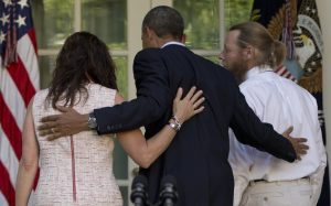 President Barack Obama, center, walks with Jani Bergdahl, left, and Bob Bergdahl, right, to the Oval Office White House in Washington, Saturday, May 31, 2014, after speaking about the release of their son, U.S. Army Sgt. Bowe Bergdahl. Bergdahl, 28, had been held prisoner by the Taliban since June 30, 2009. He was handed over to U.S. special forces by the Taliban in exchange for the release of five Afghan detainees held by the United States. (AP Photo/Carolyn Kaster)