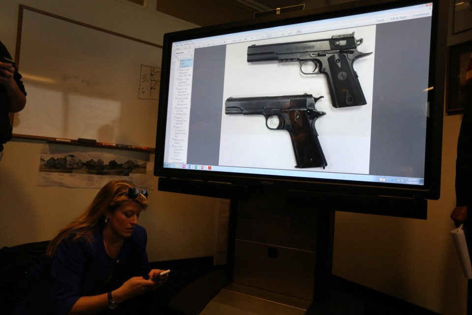 An image of a 1911 pistol and an airsoft version of the same pistol, as shown at the press conference by Prosecutor Tim McGinty (photo: Cleveland Plain Dealer)