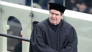 Justice Antonin Scalia wearing a replica of the toque worn by martyr Thomas More