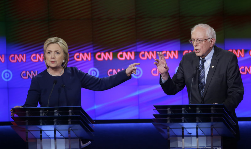 Hillary Clinton and Bernie Sanders at the Democratic Debate in Flint, MI on March 6, 2016 (photo: Carlos Osorio/AP)