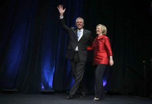 FAIRFAX, VA - JUNE 26: Democratic U.S. presidential hopeful and former U.S. Secretary of the State Hillary Clinton comes on the stage with Virginia Governor Terry McAuliffe during the Democratic Party of Virginia Jefferson-Jackson dinner June 26, 2015 at George Mason University's Patriot Center in Fairfax, Virginia. It's the first visit for Clinton since she announced her candidacy. (Photo by Alex Wong/Getty Images)