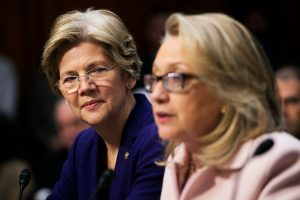 "Senator Elizabeth Warren, a Democrat from Massachusetts, left, looks on as U.S. Secretary of State Hillary Clinton speaks during a Senate Foreign Relations Committee nomination hearing in Washington, D.C., U.S., on Thursday, Jan. 24, 2013. Senator John Kerry stressed the need to prevent Iran from acquiring nuclear weapons. He described the ""immediate, dangerous challenges"" facing the nation as he seeks confirmation to become secretary of state. Photographer: Andrew Harrer/Bloomberg via Getty Images"
