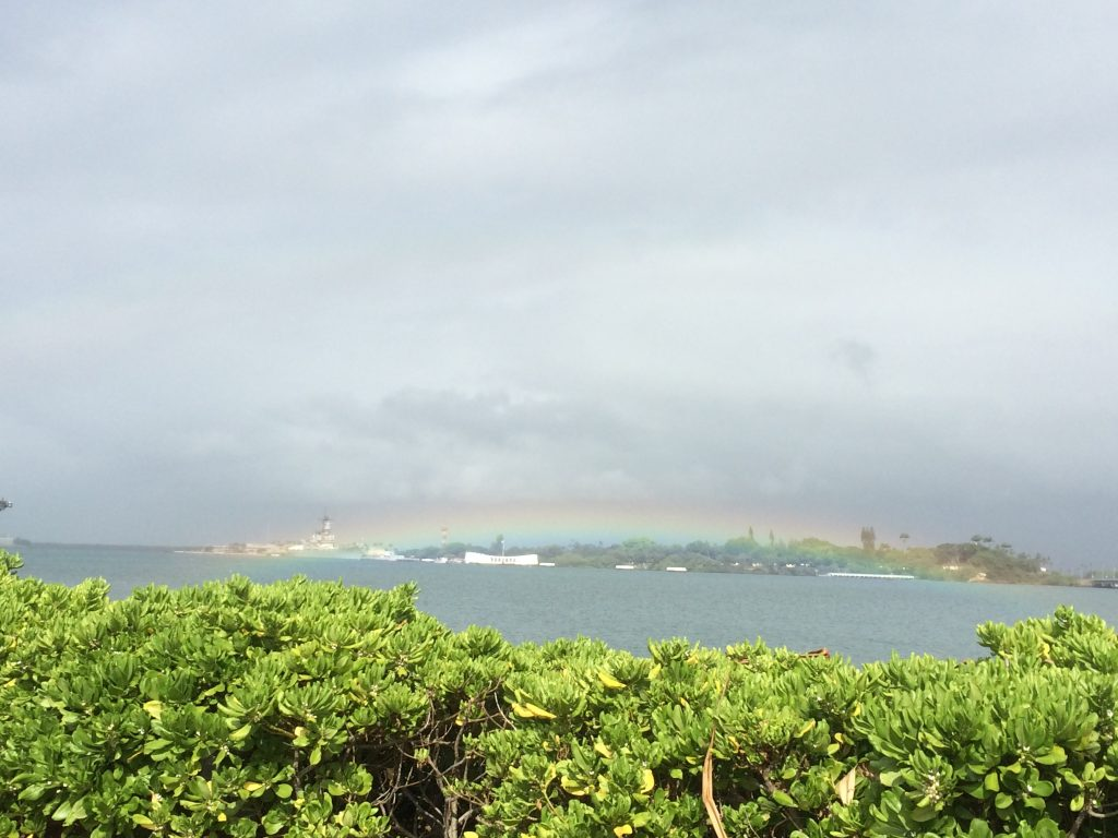 The USS Missouri and the USS Arizona Memorial, covered by a rainbow, July 3, 2016