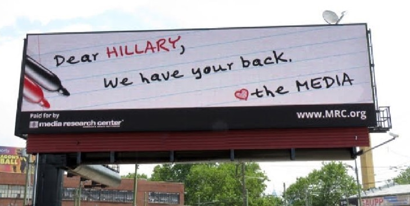 Brent Bozell, president of the Media Research Center, says MRC has erected billboards and sidewalk signs like this one all around Philadelphia. (Photo Credit: Washington Examiner)