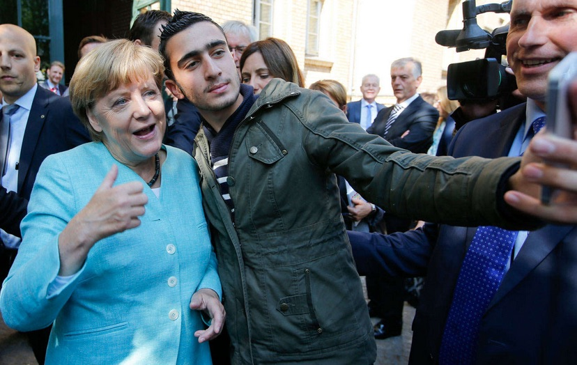 Angela Merkel snaps a selfie with a refugee outside a camp Berlin's Spandau district. (Photo Credit: The Nation)