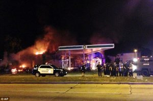 BP Gas Station on fire in Milwaukee. credit Associated Press