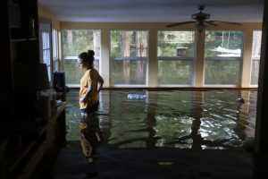 Leslie Andermann Gallagher surveys the flood damage to her home on August 17, 2016 in Sorrento, Louisiana. Last week Louisiana was overwhelmed with flood water causing at least twelve deaths and thousands of homes damaged by the flood waters. Joe Raedle, Getty Images