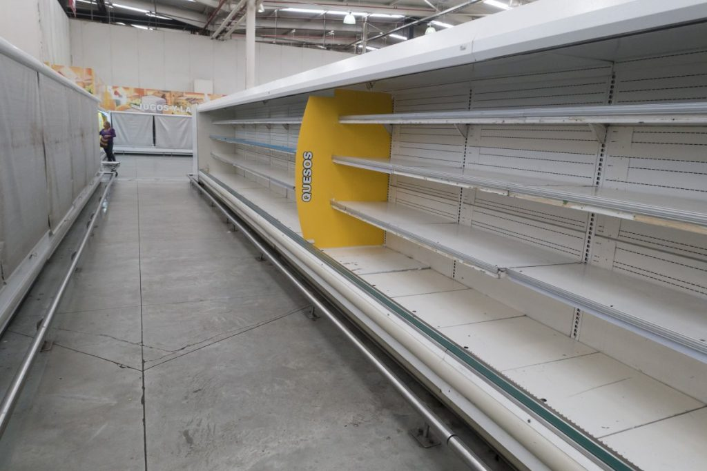 Empty refrigerator shelves at a supermarket in Caracas, on August 4 (photo: Reuters/Carlos Garcia Rawlins)