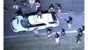 Protestors trash a police cruiser