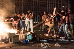 CHARLOTTE, NC - SEPTEMBER 21: Protestors put cargo from tractor trailers onto a fire on I-85 (Interstate 85) during protests following the death of a man shot by a police officer September 21, 2016 in Charlotte, North Carolina. The protests began last night, following the fatal shooting of 43-year-old Keith Lamont Scott at an apartment complex near UNC Charlotte. (Photo by Sean Rayford/Getty Images)