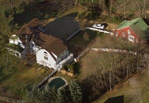 FILE - In this Jan. 5, 2000, file photo, the President Bill Clinton and Hillary Rodham Clinton's home is seen from the air in Chappaqua, N.Y. The server computer that transmitted and received Hillary Clinton's emails on a private account she used exclusively for official business when she was secretary of state traced back to a residential Internet service registered at her family's five-bedroom home in Chappaqua, according to Internet records reviewed by The Associated Press. (AP Photo/Kathy Willens, File)