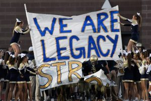 WESTMINSTER, CO - SEPTEMBER 16: Legacy players prepare to bust through the banner held by the cheerleaders after the coin toss. Legacy played Prairie View in their homecoming football game on Friday, September 16, 2016 at North Stadium. (Photo By John Leyba/The Denver Post)