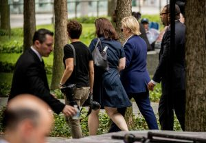 Democratic presidential candidate Hillary Clinton, second from right, departs after attending a ceremony at the Sept. 11 memorial, in New York, Sunday, Sept. 11, 2016, on the 15th anniversary of the Sept. 11 attacks. (AP Photo/Andrew Harnik)