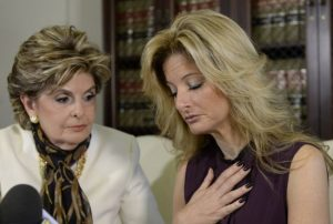 Summer Zervos, a former contestant on the TV show The Apprentice, reacts next to lawyer Gloria Allred (L) while speaking about allegations of sexual misconduct against Donald Trump during a news conference in Los Angeles, California, U.S. October 14, 2016. REUTERS/Kevork Djansezian - RTSSAXX