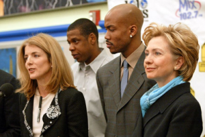 Caroline Kennedy, Jay Z and Hillary and unidentified man.