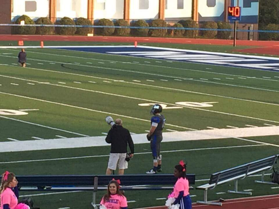 Connor Brewer alone on the sidelines, standing (photo: Jeff Hill)