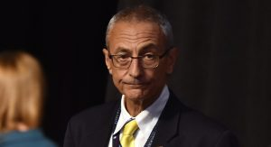 John Podesta, Chairman of the 2016 Hillary Clinton presidential campaign, looks on before the first vice presidential debate at Longwood University in Farmville, Virginia on October 4, 2016. / AFP / Paul J. Richards (Photo credit should read PAUL J. RICHARDS/AFP/Getty Images)