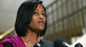 Former Hillary Rodham Clinton aide Cheryl Mills speaks to reporters on Capitol Hill in Washington, Thursday, Sept. 3, 2015, following her deposition before the panel investigating Benghazi. The committee was launched last year to investigate the Obama administration's response to the Benghazi attacks that killed four Americans, including the U.S. ambassador. The investigation has widened in recent months to focus on Clinton's use of a private email account and server. (AP Photo/Susan Walsh)