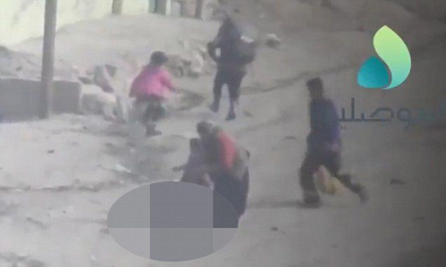 Gleefull #ISIS Sniper Laughs While Taking Shots At Woman Fleeing #Mosul [VIDEO]