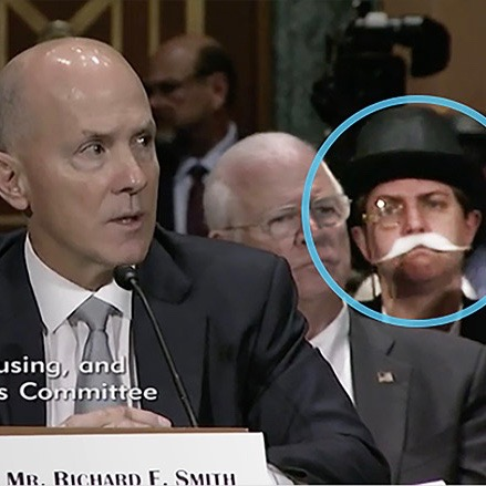 Troll Level Expert! Monopoly Man PhotoBombs Ex-CEO Richard Smith At #Equifaxhearing [VIDEO]