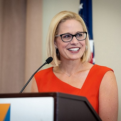 Sinema Leaves Protesters Out In The Cold, Skips Race